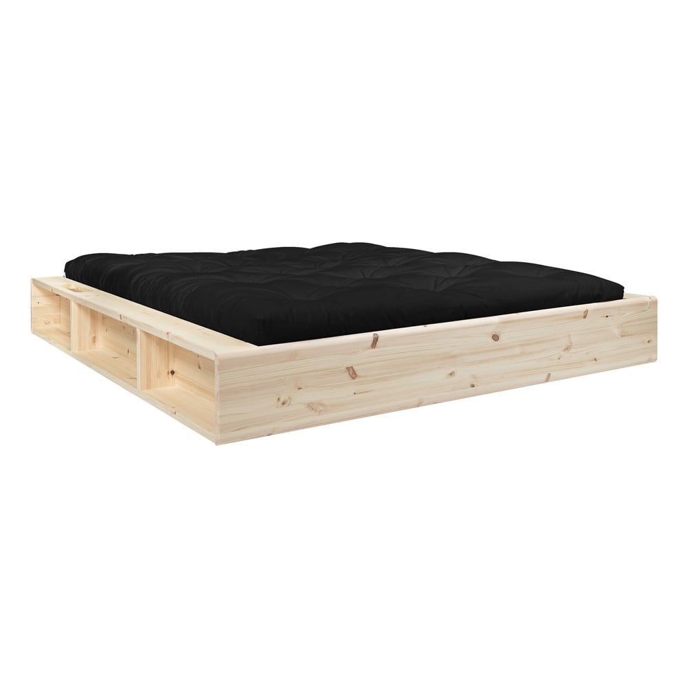 Dvojlôžková posteľ z masívneho dreva s úložným priestorom a čiernym futonom Double Latex Karup Design, 180 x 200 cm