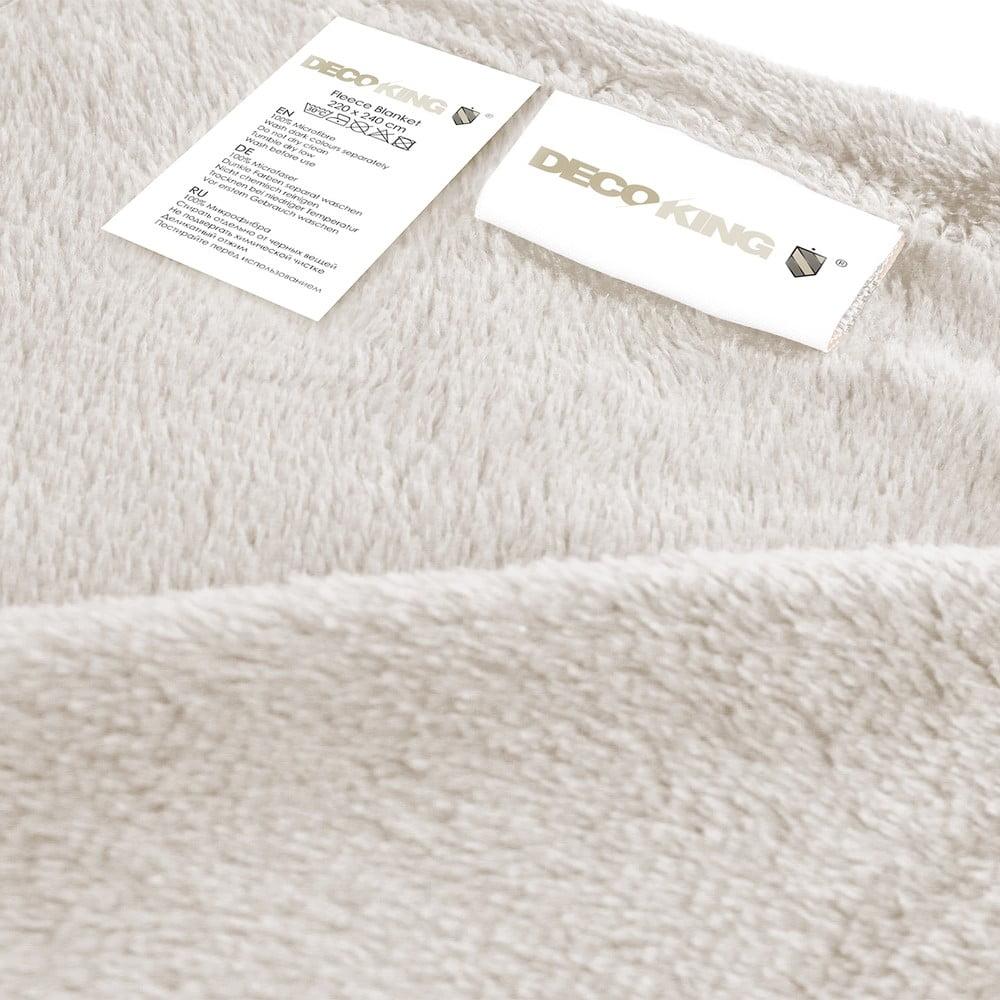 Krémovobiela deka z mikrovlákna DecoKing Mic, 220 × 240 cm Ako v objatí veľkého plyšáka sa budete cítiť v tejto hebučkej deke DecoKing.