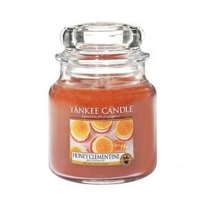 Vonná sviečka Yankee Candle Mandarínky s medom, doba horenia 65 - 90 hodín
