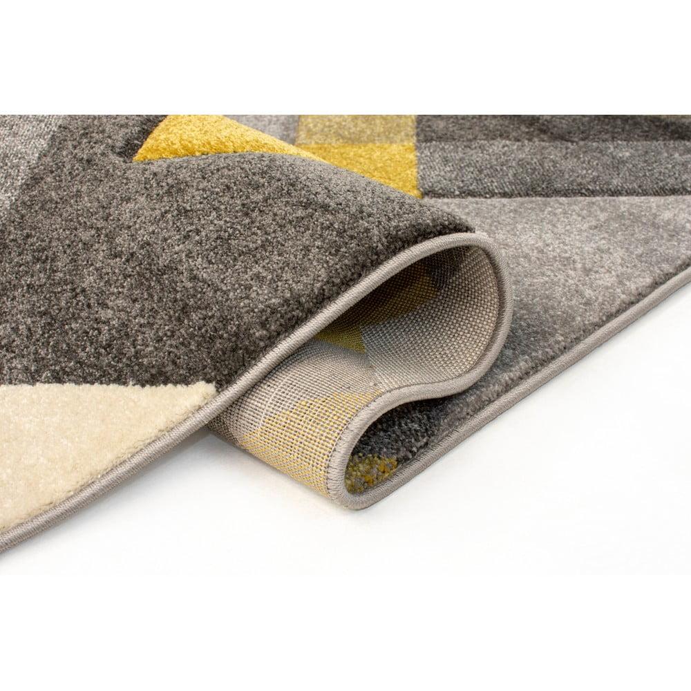 Sivo-žltý koberec Flair Rugs Nimbus Ochre, 80×150 cm Trojuholníkové tvary sú späť v móde.  <b>Prečo si zaobstarať koberec:</b> Okrem tej estetickej funkcie má aj ďalšie.